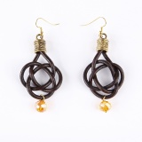 Twisted earrings with yelow crystal